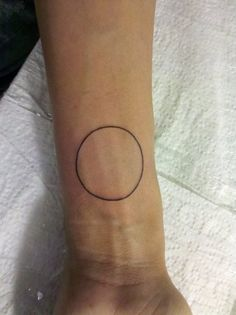 minimal black circle tattoo