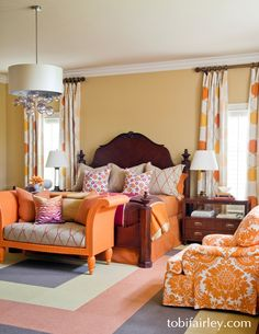 Energizing orange, pink, and yellow master bedroom by Tobi Fairley