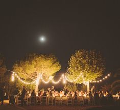 such a clean + romantic design for a lovely dinner under the stars in Spain....something about draped white lights <3