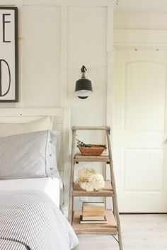 Farmhouse Master Bedroom | ladder night stand | neutral decor | farmhouse decor | swing arm lamps | ticking stripe