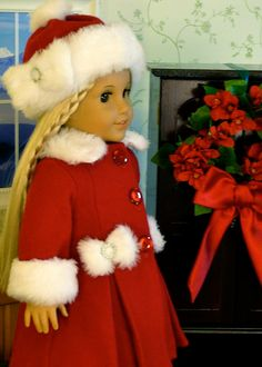 Our American Girl is ready to go Christmas shopping in her warm wool coat. It feels so cozy with the fur collar and cuffs. The hat reminds