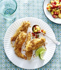 Tender and oven-fried, these chicken tenders get an extra kick of flavor from coconut. Recipe: Baked Coconut Tenders with Strawberry-Mango Salsa   - CountryLiving.com