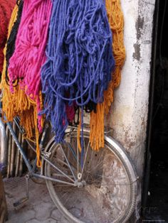 Brightly Dyed Wool Hanging Over Bicycle, Marrakech, Morrocco,