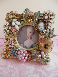 Picture frame with old jewelry embellishments
