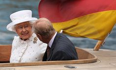 Enjoying the applause: The Queen looks up at well-wishers peering down from a bridge during her cruise up the River Spree