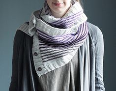 Gradient Wrap Cowl is an easy and fast project that takes a slightly different twist on the traditional cowl. It is knit lengthwise (working back and forth on a circular needle), and features 3 different sections of stripes using 3 different colors to create a gradient affect. Once complete, stitches are picked up on either end to create button bands.