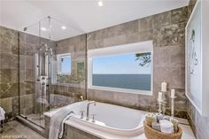 Stunning bath with glass shower and tub in New Buffalo, MI | Listed by Chad