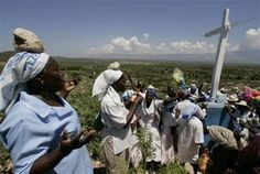 Haitian women pray as they carry stones on their head as a religious offering during a pilgrimage at the mount of Calvaire Miracle during Good Friday - Haitian Easter Sunday - Google Search