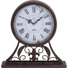 Perfect for keeping an eye on the time while bringing eye-catching appeal to your dcor, this clock is a delightful finishing touch for your living room, study, or master suite.  Product: ClockConstruction Material: MetalColor: Brown and whiteDimensions: 13 H x 13 W x 3 DNote: Batteries not includedCleaning and Care: Wipe with a dry cloth