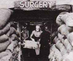 Doctors performing surgery in an underground operating room in the south Pacific, WWII.