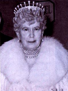 Queen Mary, wearing the diamond lozenge tiara she later passed onto her granddaughter, Princess Margaret, after the pearl spike were removed.