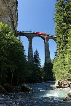 Bernina train on the Landwasser Viaduc. National Geographic rates the Bernina Express as the second best rail journey in Europe.  The first, also in Switzerland, is The Chocolate Train, but it is a commercial enterprise.  On the other hand, the Bernina transports commuters across the Alps between Switzerland and Italy on a regular basis on one of the most majestic rail experiences imagineable.
