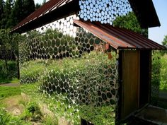Covered with thousands of round mirrors, this shed merges with the surrounding area.   Inspiration to disguise shed using cast off cds?