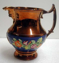 Date:  19th century                                                       Culture:                                      British                                                       Medium:                                      Lustreware                                                       Dimensions:                                      6 3/4 in.  (17.1 cm)                                                       Classification:                                      Ceramics