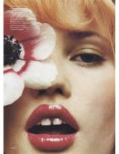 Lara Stone has that perfect body+ quirky gap tooth smile. Supposedly she walks like Lurch on the runway.