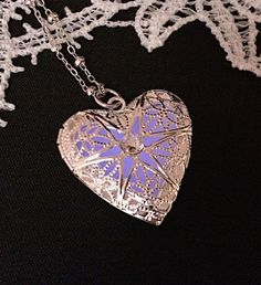 A personal favorite from my Etsy shop https://www.etsy.com/listing/223310501/heart-glow-in-the-dark-locket-pendant
