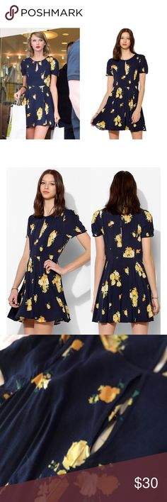 Kimchi Blue Floral Ruby Keyhole Fit Flare Dress Soft woven fit & flare dress from Kimchi Blue with a keyhole cutout along the scoopneck and a slit back with button closure.Hidden zip at the side. Urban Outfitters Dresses Midi