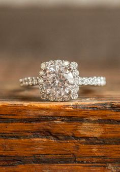Pretty engagement ring... Love the round stone making it look like a princess cut