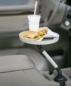 Keep snacks, maps, paper and pen within arm's reach while driving with this vehicle tray. Boasting a nonskid surface and durable construction that allows it to swivel or lock into place, it's perfect for keeping clean at the drive-in or jotting down directions.