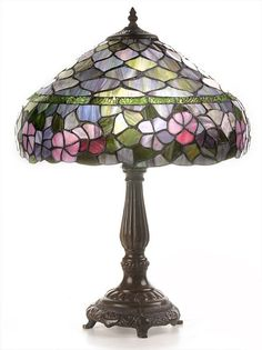 This Peony table lamp has been handcrafted using methods first developed by Louis Comfort Tiffany.