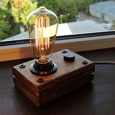 A wooden lamp, in the style of industrial, a steampunk for retro lamps EDISON. The lamp is made by hand from natural wood, polished and covered with Danish oil. The lamp has a dimmer to adjust the brightness. DETAILS - Base Dimensions: 16cm*11cm*5,5cm(6,5*4,5*2,5 inch) -Full height - 19,0cm (7,6 inch) - Cord Length: 160cm(64 inch) (european-type plug), for US users, Canada and Australia comes bundled with plug adapter - 40 watt Edison bulb INCLUDED in the PACKAGE!! - E27 base | 60 watt max…
