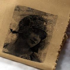 transfer an image onto clay to make your own pendant