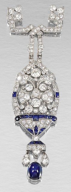 A BELLE EPOQUE SAPPHIRE AND DIAMOND BROOCH, CIRCA 1915. Of openwork stylised floral and foliate design, millegrain-set with single- and circular-cut diamonds embellished with buff-top sapphires and suspending a cabochon sapphire drop, maker's marks. #BelleEpoque #brooch