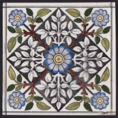 Aesthetic style tile transfer printed in black and hand-tinted, depicting a brilliant cornflower blue central flower with brown stems and two-tone green leaves radiating out from it and terminating at...