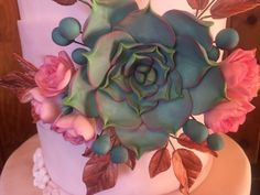 Cake with gum paste flowers and succulents