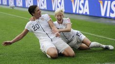 Abby Wambach and Megan Rapinoe, two players challenging the decision to play the Women's World Cup on artificial turf fields, celebrate a goal during the 2011 World Cup.  They are fighting to play on grass, like the men.  Turf causes more injuries and changes the way the game is played.