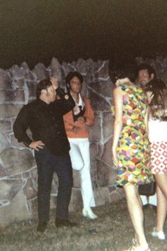 Elvis chatting with fans at the Graceland gates. Memphis Mafia friends of Elvis...Alan Fortas and Joe Esposito
