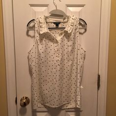 J. Crew sleeveless polka dot dress blouse. Beautiful polka dot button down close.  Traditional collar in the front with a ruffling in the back for a cute feminine touch.  Off white/cream with black dots.  Mother of pearl style buttons.  Classic and can be worn year round!  Wear under a black blazer or cardi in colder weather or alone in the summer.  Excellent gently worn condition. J. Crew Tops Button Down Shirts