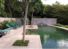 pool with a cut out stair, tree planters, large tiles cut to size for pool surround