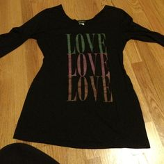 3/4 sleeve, black 'LOVE' shirt Black 3/4 sleeve shirt, green, pink and orange 'LOVE' written on front, scoop neck, I am usually a medium, this shirt may run small for a large. Dots Tops