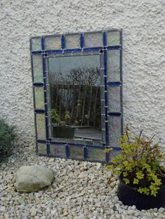 Iridescent glass mirror  with decorative border. Bespoke and made-to-order.