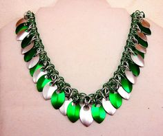 """This piece sparkles and jingles! 18 1/2"""" long in green, seafoam, and frost. Snag it for $60."""