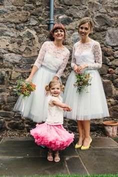 The bride wears an ostrich feather skirt and silk cami top by Charlie Brear for her Summer wedding at 'The Byre at Inchyra' in Perthshire, Scotland. Images by 'Photos by Zoe'.