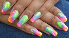 Really pretty multicolored spring pastel nails!  Looks like it was done by dragging a toothpick over the wet polish
