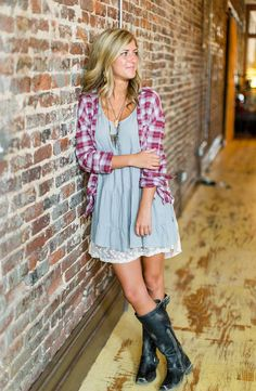 Adding a plaid shirt to a dress and boots is a great way to transition into fall