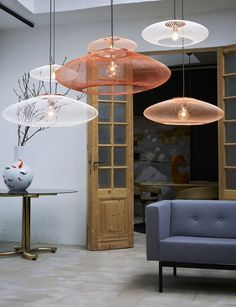 The pendants are not really suit the style of the room. They have been hung too low as well.