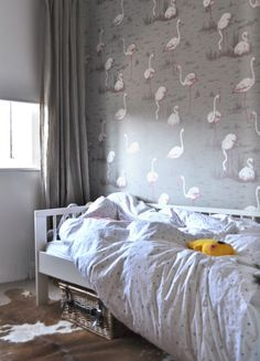 Girly room.  Love this wallpaper and how the curtains are hung at the ceiling.