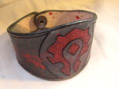 Leather bracelet with bloody Horde symbol from World of Warcraft by ScreamingNorth on Etsy https://www.etsy.com/listing/193180028/leather-bracelet-with-bloody-horde