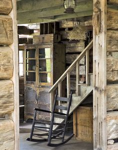 Stairs to Loft in the unchinked log cabin. Simple wooden stairs lead to a loft.