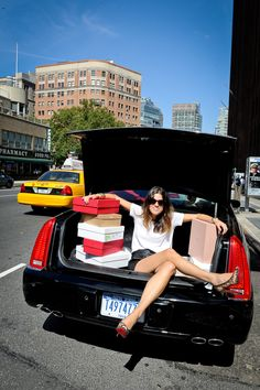 This is how NYC girls travel...in a Lincoln with a trunk full of shoes....(<3 Manrepeller!)