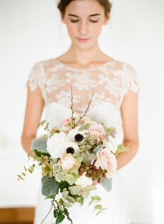 Wedding bouquet with anemones and blush pink roses
