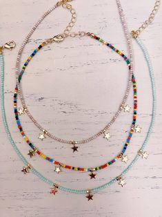 -Beaded Chokers topped with gold stars! -Dainty chokers that would look perfect with any outfit! Beaded Choker Necklace, Beaded Jewelry, Handmade Jewelry, Necklaces, Diy Beaded Bracelets, Hippie Bracelets, Beaded Anklets, Beaded Bracelet Patterns, Seed Bead Necklace