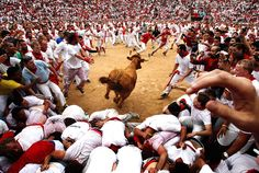 Running with the bulls at the San Fermin Fiesta, in Pamplona, Spain, on July 8, 2012