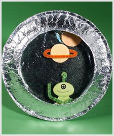 Cute spaceship porthole craft w/ paper plates, aluminum foil, pipe cleaners. Could pre-make some aliens and planets for the little ones, if needed?