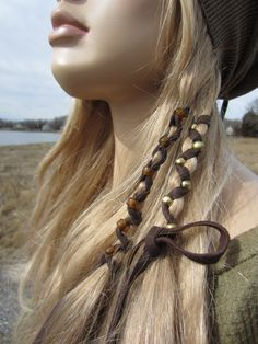 2 Bohemian Hair Wraps Ponytail Holders Leather Featehr Fringe Hair Extensions. $17.00, via Etsy.
