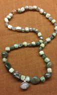 Tumbled moss agate with wonderful luster mixed with Ching Hai stone . Clasp in 925 sterling silver .